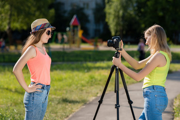 For the girl's girlfriend. Summer in nature. In the Hat and sunglasses. Conduct a conversation. Record vlog and blog subscribers. Record video lesson for Internet. Use camera with tripod.