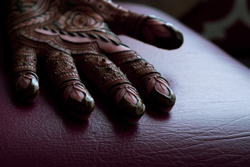Bridal henna being applied to hands
