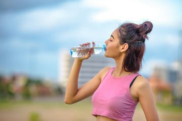 Asian women drinking water.
