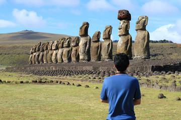 One man admiring the huge Moai statues of Ahu Tongariki, Easter Island, Chile, South America