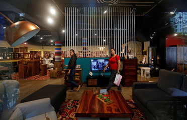 People walk inside a Pepperfry Studio outlet in Mumbai