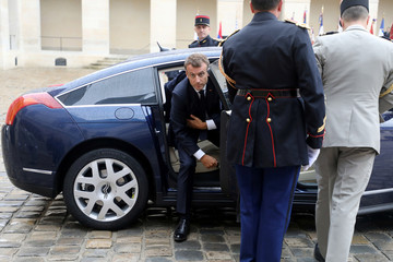 "French President Emmanuel Macron arrives to attend the ""prise d'armes"" military ceremony at the Invalides in Paris"