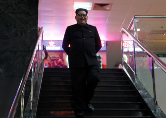 Howard, an Australian-Chinese impersonating North Korean leader Kim Jong-un, walks down the stairs in Orchard Towers in Singapore