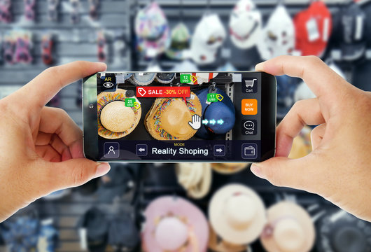 Augmented reality marketing in Department store. Hand holding smart phone use AR application to shopping online, check information and promotion.