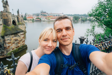 Young happy couple making selfie in the center of Prague.