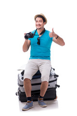 Traveler with much luggage isolated on white background