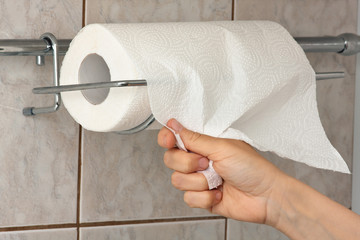 hand with paper towel