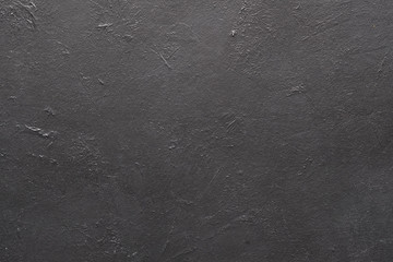 abstract grey textured dust background. distressed monochrome scratched stucco design. free space concept