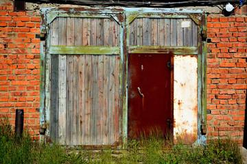 Abandoned garage with white gates.
