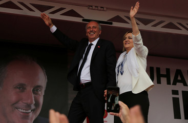 Muharrem Ince, presidential candidate of the main opposition CHP, is accompanied by his wife Ulku Ince as he greets his supporters during an election rally in Diyarbakir