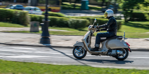 Man riding a classic scooter