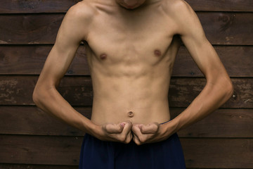 Slim Muscle man pretending to show the wooden floor backdrop.