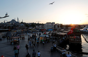 People stroll by the Golden Horn in Istanbul