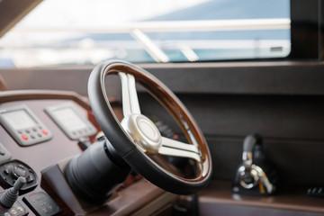 Steering wheel. Luxury traveling. Interior of modern motor yacht.