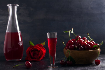 Homemade cherry alcohol drink liquor with fresh cherry berries