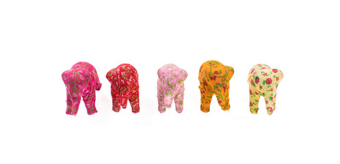 colored toy elephants on a white background