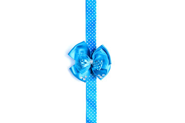 Blue gift satin bow and ribbon in polka dots isolated on white background