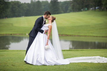 happy bride and groom on golf course