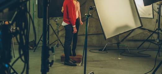 actor and actress posing in studio