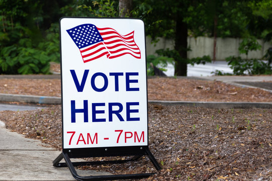 Sign for polling location to vote for elected government officials.