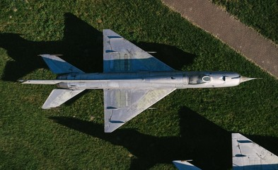 Aerial drone view on old jet fighters.