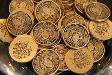 Ball markers are displayed for sale in the clubhouse at Trump Golf Links at Ferry Point in New York