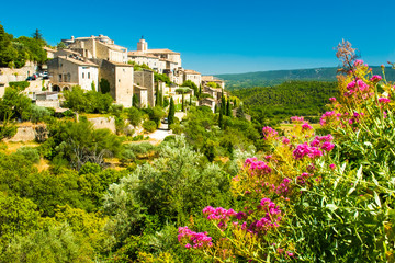 Ancient medieval village with flowers of Gordes, Provence, France
