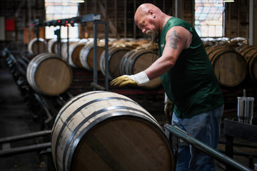 A worker inspects new whiskey barrels at the Buffalo Trace Distillery in Frankfort