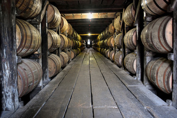 Bourbon barrels line a warehouse at the Buffalo Trace Distillery