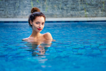 Retreat and vacation.. Beautiful young woman relaxing in spa swimming pool.
