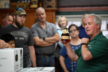 A tour guide explains the process of bottling Kentucky Bourbon Whiskey at the Buffalo Trace Distillery in Frankfort