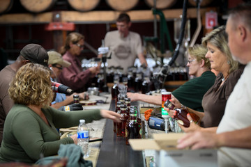 Workers label and prepare bottles of bourbon for shipment at the Buffalo Trace Distillery in Frankfort