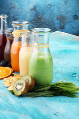 Selection of colorful smoothies on rustic background