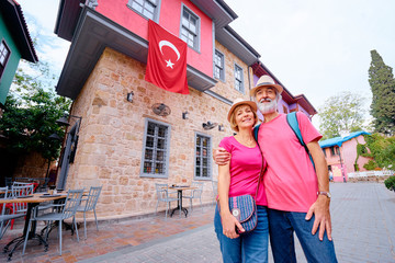Travel and tourism. Senior family couple walking together on Turkey's street.
