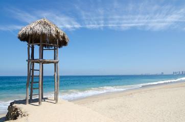 Palapa hut at the white-sand beach