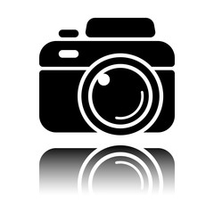 Photo camera, simple icon. Black icon with mirror reflection on white background