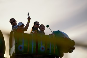 Adults and childrens ride on the Russian roller coaster
