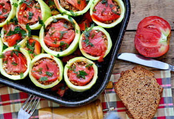 Zucchini stuffed with minced meat, rice and tomatoes. Ready for eat.