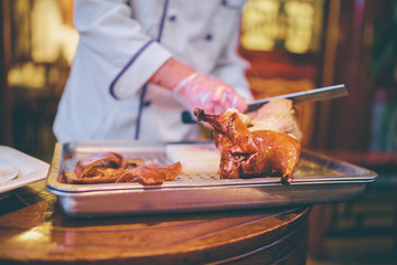 Preparation of Peking Roast Duck. Peking Duck is a famous duck dish from Beijing.