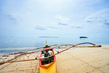 Beautiful landscape - tropical white sand beach with fishing boats. Siargao Island, Philippines.