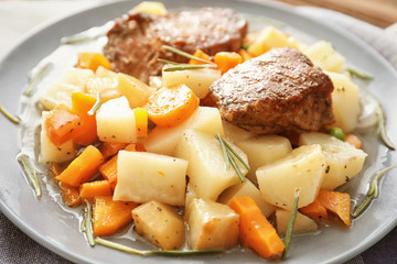 Plate with tasty meat and potatoes, close up