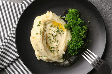 Plate with mashed potatoes on table
