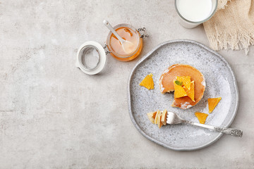 Flat lay composition with tasty pancakes on grey background