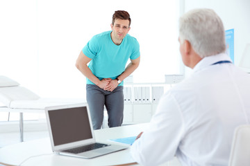 Man with health problems visiting urologist at hospital