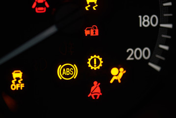 Colorful error sign on car dashboard