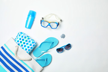 Composition with beach objects on white background