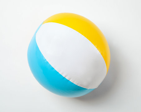 Inflatable ball on white background. Beach object