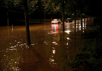 Cars are stopped on the Quai d'Ouchy after a flash flooding during a heavy rain fall in Lausanne