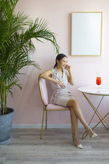 One young asian woman in pink cafe