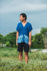 Asian man wearing Shibori natural indigo cloth